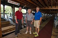 Bruce Wright, Jack Irwin and Bill Irwin on the docks at Irwin Marine on Lake Winnipesaukee. (Karen Bobotas for New England Boating Magazine)