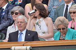 © Licensed to London News Pictures. 11/07/2019. London, UK. Actress Claire Foy watches centre court tennis in the royal box on Day 10 of the Wimbledon Tennis Championships 2019 held at the All England Lawn Tennis and Croquet Club. Photo credit: Ray Tang/LNP