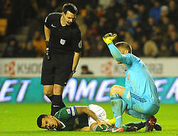 Nico Yennaris of Brentford picks up an injury -Mandatory by-line: Nizaam Jones/JMP - 02/01/2018 - FOOTBALL - Molineux - Wolverhampton, England- Wolverhampton Wanderers v Brentford -Sky Bet Championship