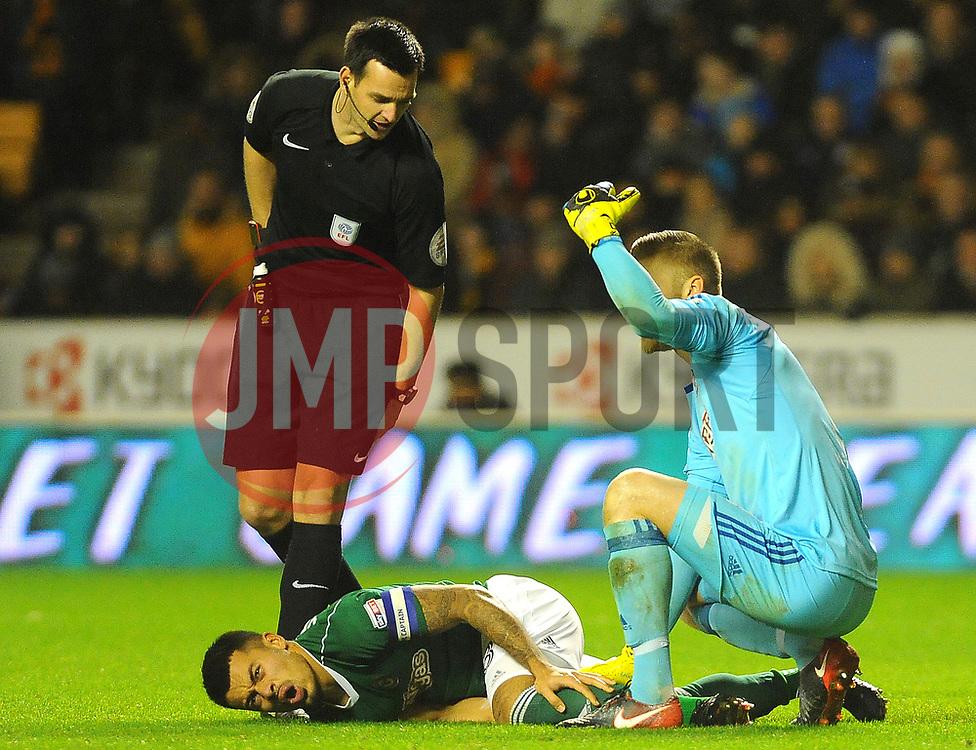 Nico Yennaris of Brentford picks up an injury -Mandatory by-line: Nizaam Jones/JMP - 02/01/2018 - FOOTBALL - Molineux - Wolverhampton, England- Wolverhampton Wanderers v Brentford -Sky Bet Championship