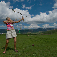 A traveler shoots a Mongolian bow at a ger camp in Gorkhi  Terelj National Park, north of Ulaanbaator.