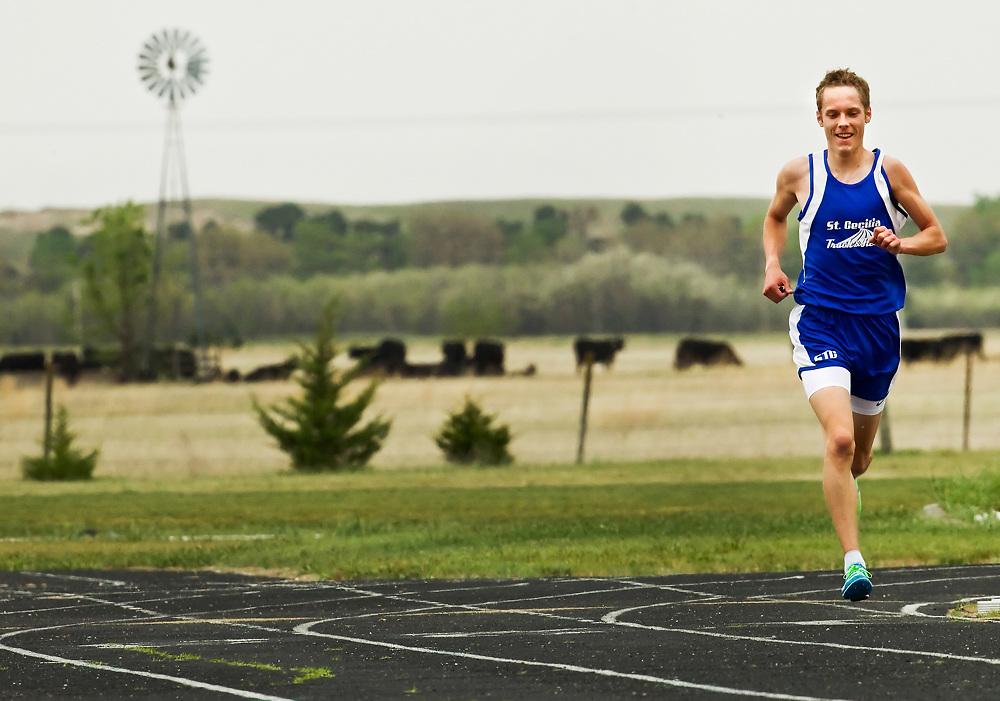 Hastings St. Cecilia's Jordan Potzeba competes in the 3200-meter run during Thursday's Centura Invitational at Centura High School. (Independent/Matt Dixon)