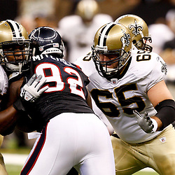 August 21, 2010; New Orleans, LA, USA; New Orleans Saints center Matt Tennant (65) and offensive tackle Na'Shan Goddard (70) block against Houston Texans defensive tackle Earl Mitchell (92) during the second half of a 38-20 win by the New Orleans Saints over the Houston Texans during a preseason game at the Louisiana Superdome. Mandatory Credit: Derick E. Hingle