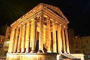 The Temple d'Auguste et de Livie - The temple of Augustus and Livia - in Vienne, floodlit at night. Similar to the Maison Carre in Nimes. The oldest parts date to the first 1st century, was re-built under emperor Augustus and his spouse Livia.  Vienne, Isère Isere, France, Europe