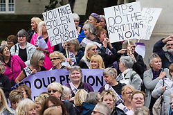 © Licensed to London News Pictures. 29/06/2016. WASPI - Women Against State Pension Inequality Campaign(WASPI) protesters demonstrate in Parliament on the same day on 29th June 1909 did when Emmeline Pankhurst marched to Parliament with hundreds of Suffragettes, to present a petition to Prime Minister Asquith. WASPI camapgin group fights injustice done to women born in the 1950s (on or after 6 April 1951) regarding the changes to their state pension age.  London, UK. Photo credit: Ray Tang/LNP
