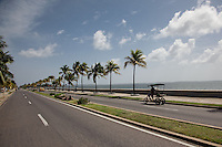 Heading along the waterfront in Cienfuegos, Cuba.