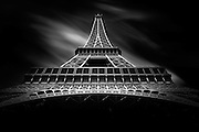 An impressive view of the eiffel tower from the floor. The lines of this amazing architectural construction lead to the top.