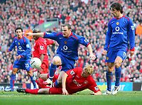 Wayne Rooney is tackled by Liverpool's Sami Hyypia<br />