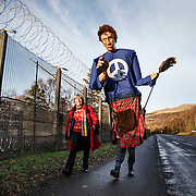 Faslane anti-Trident demo. Protestors at the entrance to Faslane Naval base near Helensburgh. Picture Robert Perry for The Evening Times 30th Nov 2014<br /> <br /> Must credit photo to Robert Perry<br /> FEE PAYABLE FOR REPRO USE<br /> FEE PAYABLE FOR ALL INTERNET USE<br /> www.robertperry.co.uk<br /> NB -This image is not to be distributed without the prior consent of the copyright holder.<br /> in using this image you agree to abide by terms and conditions as stated in this caption.<br /> All monies payable to Robert Perry<br /> <br /> (PLEASE DO NOT REMOVE THIS CAPTION)<br /> This image is intended for Editorial use (e.g. news). Any commercial or promotional use requires additional clearance. <br /> Copyright 2014 All rights protected.<br /> first use only<br /> contact details<br /> Robert Perry     <br /> 07702 631 477<br /> robertperryphotos@gmail.com<br /> no internet usage without prior consent.         <br /> Robert Perry reserves the right to pursue unauthorised use of this image . If you violate my intellectual property you may be liable for  damages, loss of income, and profits you derive from the use of this image.