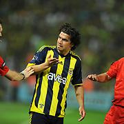 Referee's Yunus YILDIRIM (R) and Fenerbahce's Mehmet TOPUZ (C) during their Turkish superleague soccer derby match Fenerbahce between Trabzonspor at the Sukru Saracaoglu stadium in Istanbul Turkey on Sunday 16 May 2010. Photo by TURKPIX