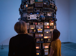 © Licensed to London News Pictures. 14/06/2016. London, UK. Two women take in 'Babel 2001', a tower of radios which all play at the same time, by Cildo Meireles at the Tate Modern gallery in London. The gallery's new ten-storey extension, the Switch House, will open to the public on Friday 17 June 2016. Photo credit: Rob Pinney/LNP