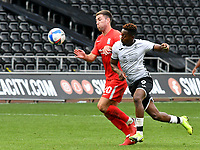 Football - 2020 /2021 EFL Championship - Swansea City vs Birmingham City <br />      <br /> Jamal Lowe of Swansea City on the attack Gary Gardner of Birmingham defends <br /> in a match played without fans at the Liberty Stadium<br /> <br /> COLORSPORT/WINSTON BYNORTH