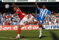 Photo: Ashley Pickering.<br /> Colchester United v Charlton Athletic. Coca Cola Championship. 15/09/2007.<br /> Kevin Lisbie of Colchester (R) challenges Jonathan Fortune of Charlton for the ball