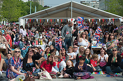 Plymouth, UK  29/04/2011. The Royal Wedding of HRH Prince William to Kate Middleton. The people of Plymouth sit in the centre watching the wedding unfold on the big screen. Photo credit should read London News Pictures. Please see special instructions. © under license to London News Pictures