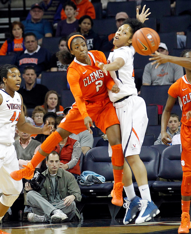 Virginia guard Ataira Franklin (23) puts pressure on Clemson guard Chelsea Lindsay (2) during the game Sunday in Charlottesville, VA. Photo/The Daily Progress/Andrew Shurtleff