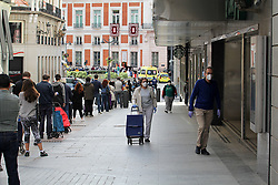 Daily life in Madrid, after new lockdown regulations in Spain, on May 02, 2020. Neighbors from Madrid wait their turn to enter a supermarket in Calle de Preciados in Madrid during the first day in which the general departures of almost the entire population are allowed, regulated by time bands. Two strips are established, in the morning and afternoon, so that those over 14 years old can go out to physically exercise individually or walk. These strips extend from 06:00 to 10:00 in the morning and from 20:00 to 23:00 at night. Separately and in attention to their special vulnerability, the strips between 10:00 a.m. and 12:00 p.m. and between 7:00 p.m. and 8:00 p.m. are defined specifically for the walks of people with special needs or those over 70 years. The walks with kids from 12:00 to 19:00. Health crisis due to the Covid-19 virus pandemic. Photo by Alejandro de Dios/AlterPhotos/ABACAPRESS.COM