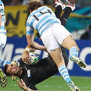 Gonzalo Camacho of Argentina tackles Ben Foden of England during the England V Argentina, Pool B match during the Rugby World Cup in Dunedin, New Zealand,. 10th September 2011. Photo Tim Clayton