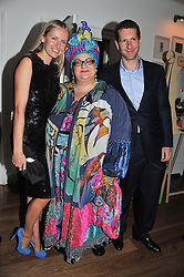 Left to right, NADYA ABELA, CAMILLA BATMANGEILEDH and MARLON ABELA at a dinner hosted by Marlon and Nadya Abela in aid of Kids Company at Morton's, Berkeley Square, London on 25th September 2012.