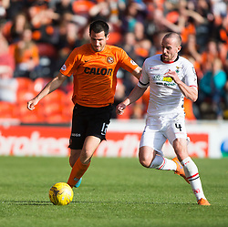 Dundee United's Ryan McGowan and Inverness Caledonian Thistle's James Vincent. <br /> Dundee United 1 v 1 Inverness Caledonian Thistle, SPFL Ladbrokes Premiership game played 19/9/2015 at Tannadice.