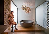 Award winning bathroom designer Jasmine McClelland<br /> and the bathroom she designed for Vicky Tsaganas. Photo By Craig Sillitoe for Home Style. 28/02/2014