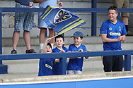 AFC Wimbledon fans waving flag during the EFL Sky Bet League 1 match between AFC Wimbledon and Oldham Athletic at the Cherry Red Records Stadium, Kingston, England on 21 April 2018. Picture by Matthew Redman.