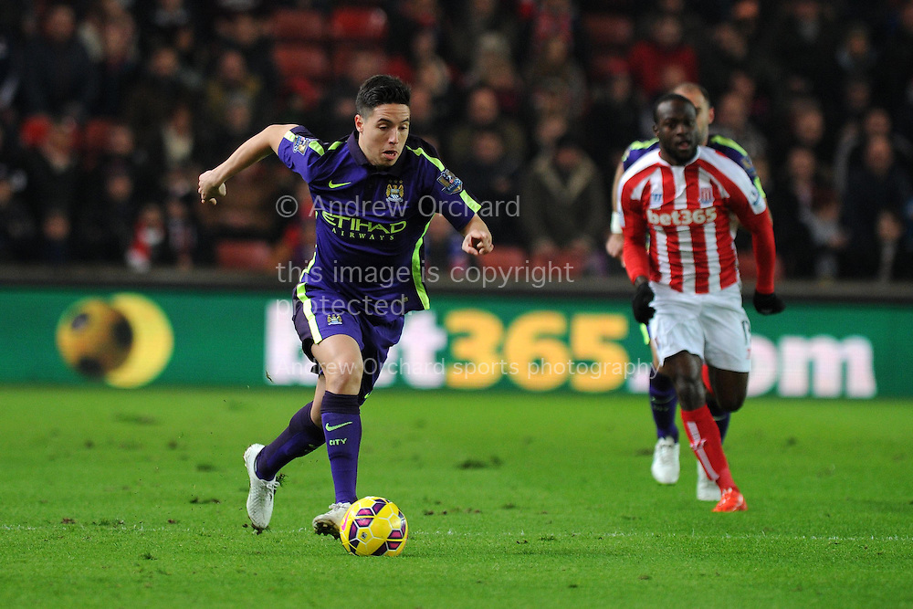 Samir Nasri of Manchester city in action.Barclays Premier League match, Stoke city v Manchester city at the Britannia Stadium in Stoke on Trent , Staffs on Wed 11th Feb 2015.<br /> pic by Andrew Orchard, Andrew Orchard sports photography.