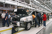 Workers on the production line at the Nissan Plant in Canton Mississippi work on assempling the new Pathfinder Armada.(photo/Suzi Altman)