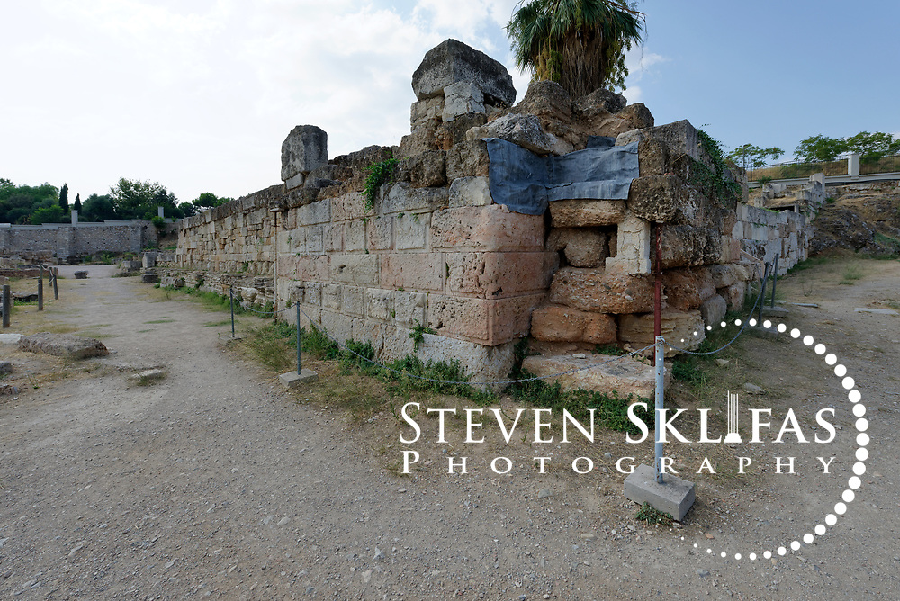 Ruins of the Sacred Gate, Kerameikos. Athens. Greece. The gate was reserved for pilgrims and priests during the procession to Eleusis. The Sacred Gate was built in the 5th century BC at the same time as the Themistocles wall and marks the beginning of the Sacred Way to Eleusis.  Serving as a burial ground as long ago as the 12th century BC, Kerameikos located in the ancient neighbourhood of potters contains part of the ancient city walls and the Dipylon, the main gate of Ancient Athens at a junction of the Sacred Way and Panathenaic Way. It served as a burial ground for the richest and most distinguished citizens of the city.