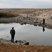 Two men fishing near Salamanca. Spain . The WAY OF SAINT JAMES or CAMINO DE SANTIAGO following the Silver Way, between Seville and Astorga, SPAIN.Tradition says that the body and head of St. James, after his execution circa. 44 AD, was taken by boat from Jerusalem to Santiago de Compostela. The Cathedral built to keep the remains has long been regarded as important as Rome and Jerusalem in terms of Christian religious significance, a site worthy to be a pilgrimage destination for over a thousand years. In addition to people undertaking a religious pilgrimage, there are many travellers and hikers who nowadays walk the route for non-religious reasons: travel, sport, or simply the challenge of weeks of walking in a foreign land. In Spain there are many different paths to reach Santiago. The three main ones are the French, the Silver and the Coastal or Northern Way. The pilgrimage was named one of UNESCO's World Heritage Sites in 1993. When there is a Holy Compostellan Year (whenever July 25 falls on a Sunday; the next will be 2010) the Galician government's Xacobeo tourism campaign is unleashed once more. Last Compostellan year was 2004 and the number of pilgrims increased to almost 200.000 people.