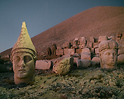 Mount Nemrut or Nemrud is a 2,134-metre-high, 7001 ft mountain in southeastern Turkey, notable for the summit where a number of large statues are erected around what is assumed to be the royal tomb of King Antiochus dating back from the 1st century BC.