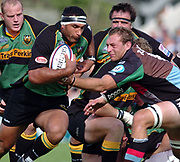 Northampton, Northamptonshire, 9th November 2004, Franklyn Gardens, Zurich Premiership Rugby Harlequins v Northampton Saints,  Andrew Blowers,  breaking from the ruck as Harlequins Karl Radzki,  [right], moves in to tackle, [Mandatory Credit: Pete Spurrier/Intersport Images],