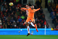 Alex Oxlade-Chamberlain of Liverpool (r) and Erik Pieters of Stoke City jump for the ball. Premier league match, Stoke City v Liverpool at the Bet365 Stadium in Stoke on Trent, Staffs on Wednesday 29th November 2017.<br /> pic by Chris Stading, Andrew Orchard sports photography.