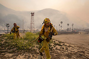 Firefighters rush to extinguish the wildfire in the Naval Base at Point Mugu Friday, May 3, 2013..(AP Photo/Ringo H.W. Chiu)