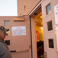Nelson Tso Sr., 74, enters the Twin Lakes Chapter house to cast his vote for the Navajo Nation Presidential election on Tuesday in Twin Lakes.