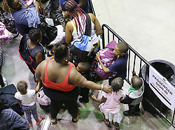 A woman and children wait in line with hundreds of other local residents being evacuated from the city inside the Savannah Civic Center during a mandatory evacuation for Hurricane Irma on Saturday, September 9, 2017, in Savannah, Ga. Officials are expecting 1,500 to 3,000 without transportation to leave by buses that are being provided. Photo by Curtis Compton/Atlanta Journal-Constitution/TNS/ABACAPRESS.COM