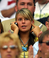 Wayne Rooney's girlfriend,Colleen McCoughlin on the phone before kick off. England v Portugal. Euro Championships 2004. 24/6/04. Credit : Colorsport/Andrew Cowie.