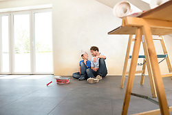 Father son working taking a break painting
