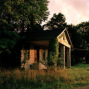 Dusk falls on a typical Mississippi veranda in a Hopper-esque fashion. Between Nesbit and Sardis just off route 55, Mississippi. When Driving through the Bible belt its great to get off the main highways and just cruise around:  that's when you get to meet the real America.