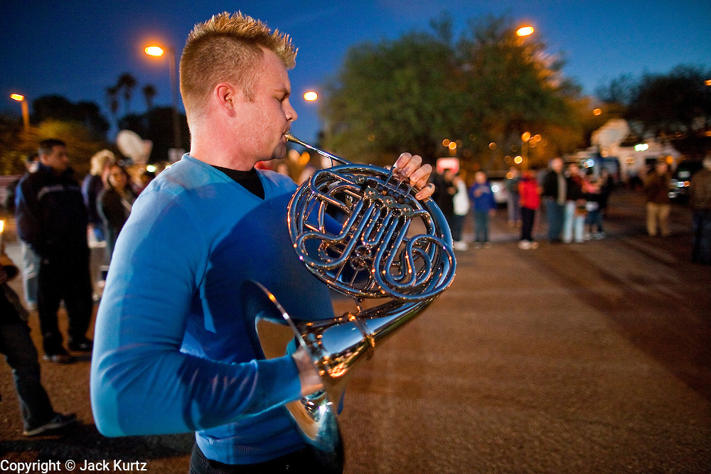 tucsonshooting - 09 JANUARY 2011 - TUCSON, AZ: Dr. Jason Curley, (CQ) a friend of Congresswoman Giffords, plays Nocturno by Strauss, at a memorial for Gabrielle Giffords at University Medical Center in Tucson Sunday night. Congresswoman Gabrielle Giffords, US Federal Judge John Roll and several other people were shot by a lone gunman in a mass shooting Saturday.     ARIZONA REPUBLIC PHOTO BY JACK KURTZ THE DOC is not a MD, he has a Phd in music.