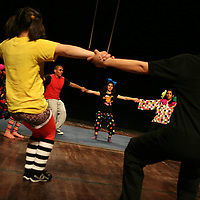 """The Palestinian Circus School members stretch before performing the show """"Circus behind the wall"""" in Ramallah, November 20, 2009.The circus group was established in 2006, in order to give a new way of expression for Palestinians, and a new way to deliver the idea of resistance to the occupation. This performance is based on the life of Palestinians behind the separation wall. Photo by Michal Fattal/backyard"""