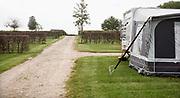 Nederland, Groesbeek, 29-04-2020 Het is voorjaarsvakantie maar campings staan voor een groot deel leeg.  Vanaf deze tijd is het seizoen en zou het vol moeten staan . Deze boerderijcamping is open, maar de toiletgebouwen zijn dicht . Foto: Flip Franssen
