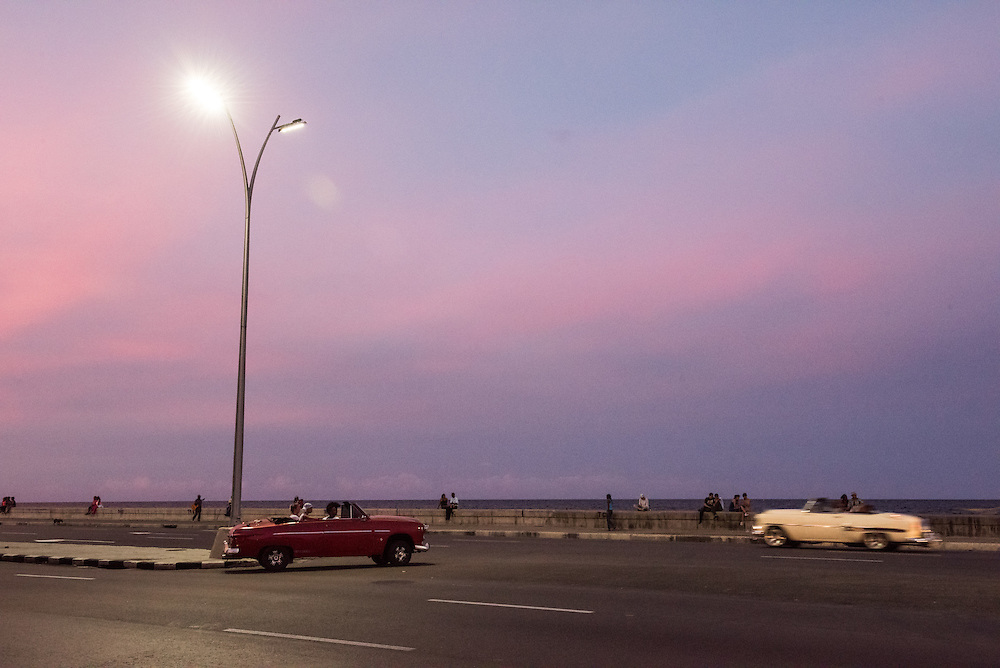 Old cars from the 1950's, travel along the Malecon January 1, 2015 in Havana, Cuba.  The United States announced last month that it will end its fifty-year trade embargo with Cuba and move to normalizing relations. Cuba's budding private sector is strengthening, but still has a long way to go to prepare for the expected stream of tourists. Photo Ken Cedeno