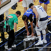 ORLANDO, FL - MARCH 01: Michael Carter-Williams #7 of the Orlando Magic and Luka Doncic #77 of the Dallas Mavericks help clean the floor after a hard foul during the first half at Amway Center on March 1, 2021 in Orlando, Florida. NOTE TO USER: User expressly acknowledges and agrees that, by downloading and or using this photograph, User is consenting to the terms and conditions of the Getty Images License Agreement. (Photo by Alex Menendez/Getty Images)*** Local Caption *** Michael Carter-Williams;  Luka Doncic