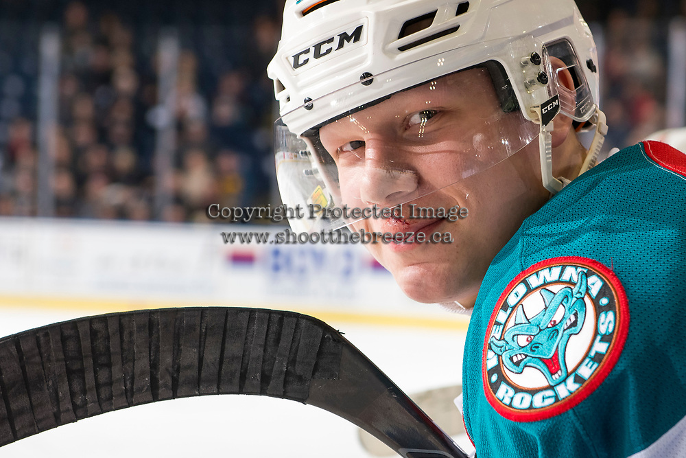 KELOWNA, CANADA - JANUARY 30: Dallon Wilton #15 of the Kelowna Rockets stands on the bench after getting  puck to the face and receiving stitches against the Seattle Thunderbirds on January 30, 2019 at Prospera Place in Kelowna, British Columbia, Canada.  (Photo by Marissa Baecker/Shoot the Breeze)
