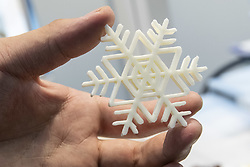 June 15, 2018 - Tokyo, Japan - An exhibitor shows a snowflake-shaped white chocolate printed with a 3D printer during the International Food Machinery and Technology Exhibition (FOOMA JAPAN) in Tokyo Big Sight, Tokyo, Japan. The annual exhibition introduces 798 companies' latest products and services for food processing industry distributed in 8 halls of Tokyo Big Sight. FOOMA JAPAN runs from June 12 to 15. (Credit Image: © Rodrigo Reyes Marin/via ZUMA Wire via ZUMA Wire)