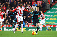 Kevin De Bruyne of Manchester City goes past Glen Johnson of Stoke City. Barclays Premier league match, Stoke city v Manchester city at the Britannia Stadium in Stoke on Trent, Staffs on Saturday 5th December 2015.<br /> pic by Chris Stading, Andrew Orchard sports photography.