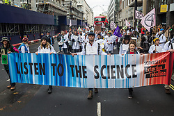 London, UK. 22 November, 2019. Climate activists from Scientists for XR attend a demonstration intended to communicate the science relating to the climate and ecological emergency. Activists were dressed in labcoats to represent the 1600 scientists worldwide who have signed the Scientists Declaration in support of non-violent direct action against government inaction against the climate and ecological emergency.