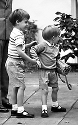 File photo dated 16/9/1987 of three year old Prince Harry receives a helping hand from his older brother Prince William on his first day at kindergarten in Chepstow Villas, Notting Hall Gate, London. Prince Harry has asked his brother the Duke of Cambridge to be his best man at his wedding to Meghan Markle, Kensington Palace said.