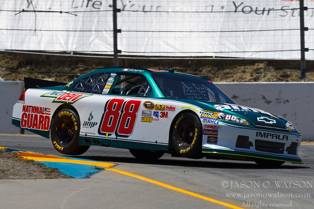 June 24, 2011; Sonoma, CA, USA;  NASCAR Sprint Cup Series driver Dale Earnhardt Jr. (88) drives through turn 4 during practice for the Toyota/Save Mart 350 at Infineon Raceway.
