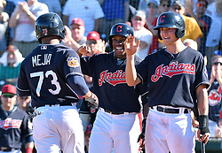 March 11, 2017 - Goodyear, AZ, USA - The Cleveland Indians' Francisco Mejia (73) is congratulated at the plate after his grand slam in the seventh inning against the Kansas City Royals during spring training at Goodyear Ballpark in Goodyear, Ariz., on Saturday, March 11, 2017. The Indians won, 7-6. (Credit Image: © John Sleezer/TNS via ZUMA Wire)